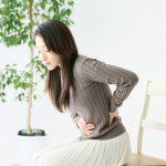 生理前のお腹の張りと腰痛はPMS?妊娠超初期症状の可能性も